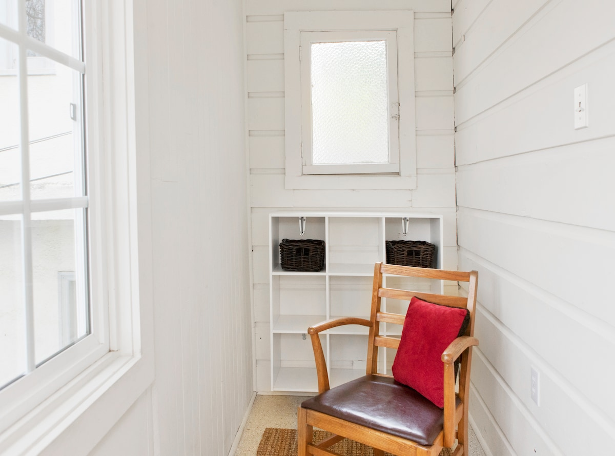 Front reading porch with views to the NE; wall-mounted shelves for storing shoes, slippers, etc.