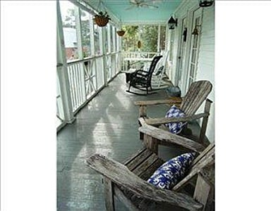 The screened front porch has seating and dining as well. Great place for the early morning coffee!