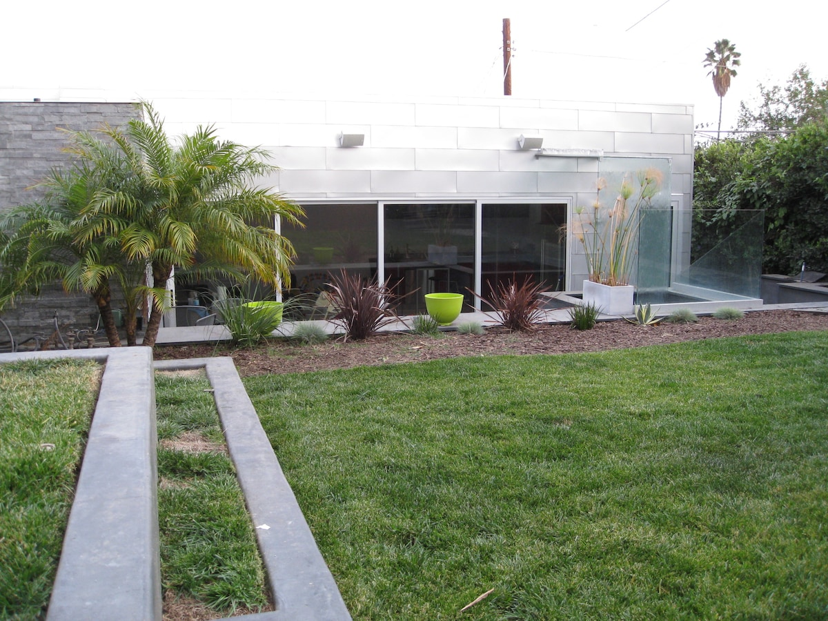 You step down from the yard to the guest house - garage is directly below the guest house