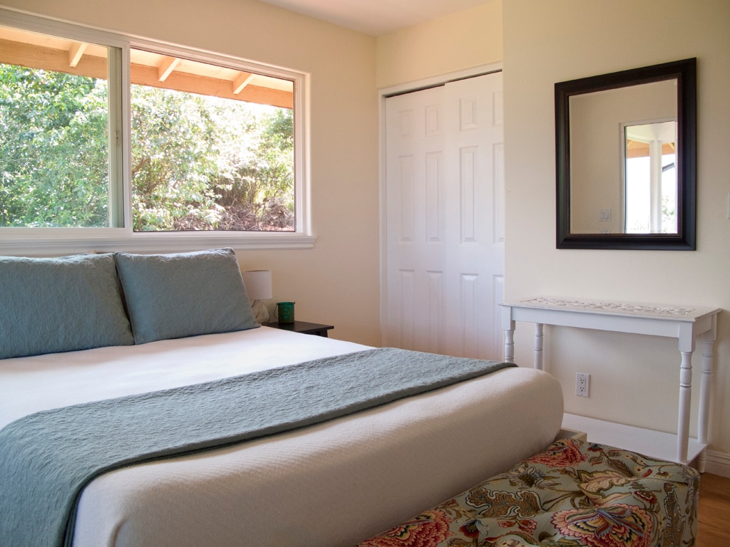 Light and bright bedroom with a brand new memory foam mattress.