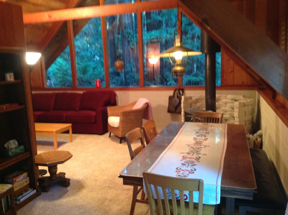 Dining Area and Family Room with view of Redwood Trees.  Wood burnng fireplaces are not for guest use.