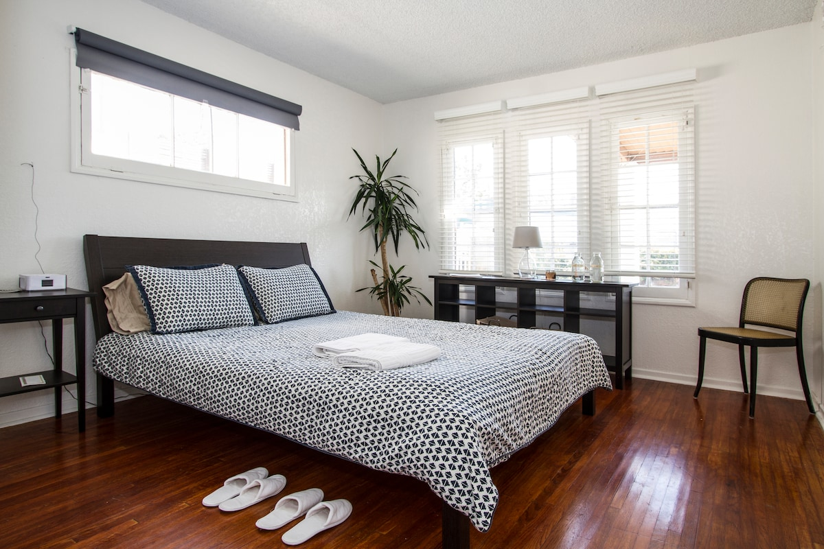 UPDATE: we now have floor to ceiling black-out curtains so you can sleep in!  Queen sized bed! Front, east-facing room: wake up to the sunrise. Pillows and mattress have hypoallergenic, waterproof covers. It's waiting for you!