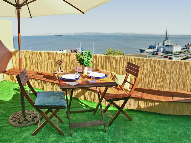 Terrace with Tagus estuary views and garden furniture, including several pillows