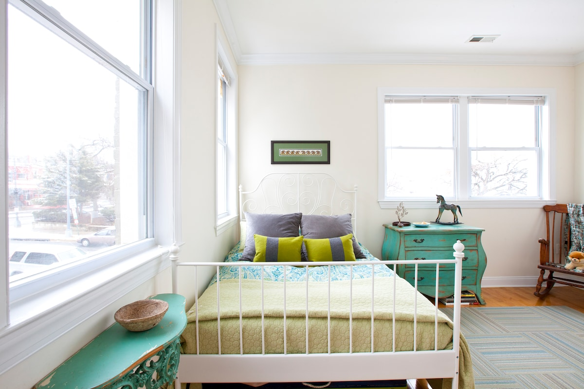 Crisp and colorful guest room with comfortable bed featuring a memory foam mattress and upscale linens