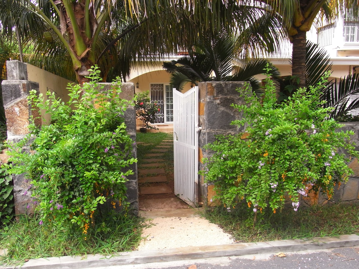 The front gate to the apartment garden.