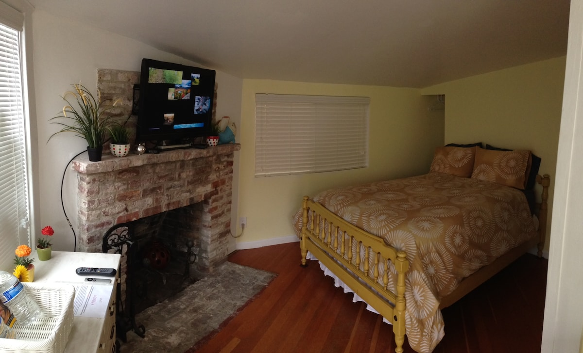As you come around the corner, you'll see the TV mounted on the wall with AppleTV, and Cable.