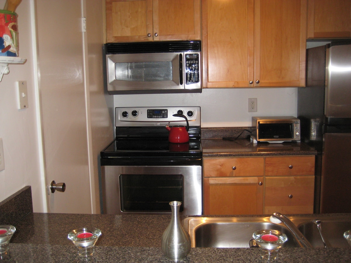 full kitchen with dishwasher, toaster, dishes, glasses, pots/pans, etc.