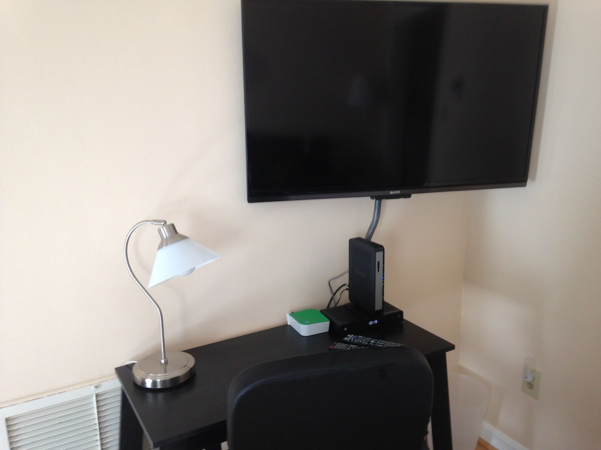46 in TV with basic cable, writing desk, WiFi.