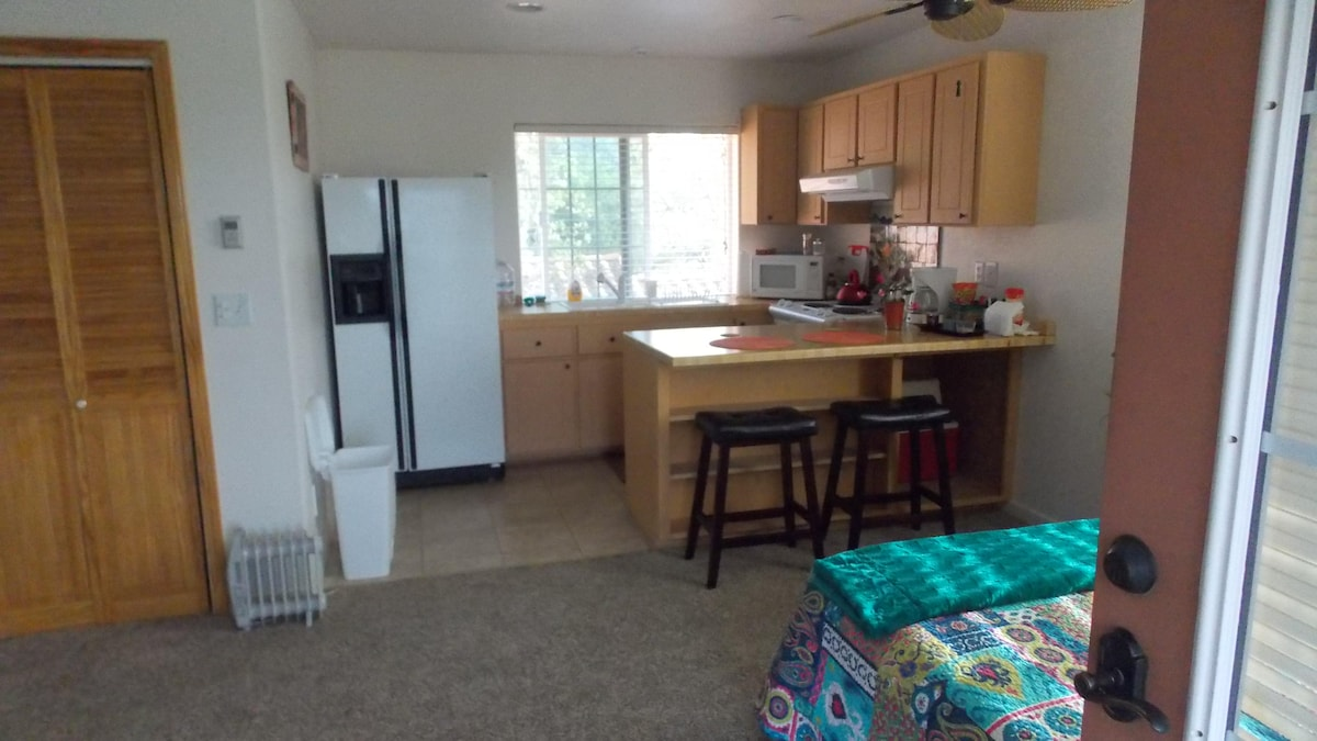 Full kitchen w/large fridge, stove, microwave,  coffee pot & toaster, dishes, pots & pans, etc.