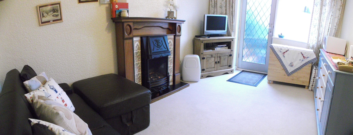 Your sitting room with TV, DVD, crockery, cutlery & Microwave.