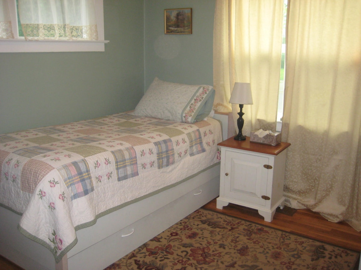 Comfy twin bed with bedside table. Plenty of blankets and pillows. More in the closet.