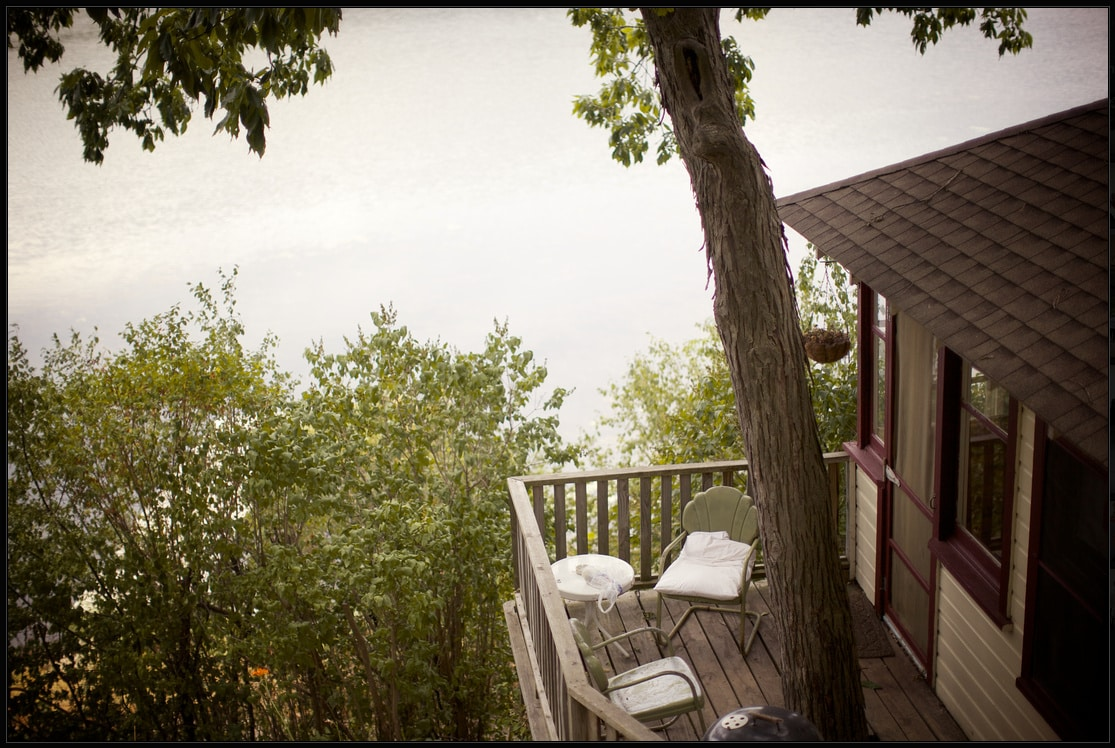 The quaint cabin is nestled on the lakes edge