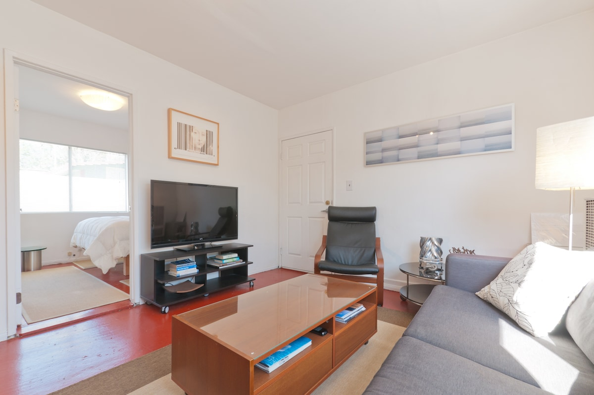 Bright and airy living room...feel free to put your feet up, or get some work done with 30 mbps Fios WiFi.