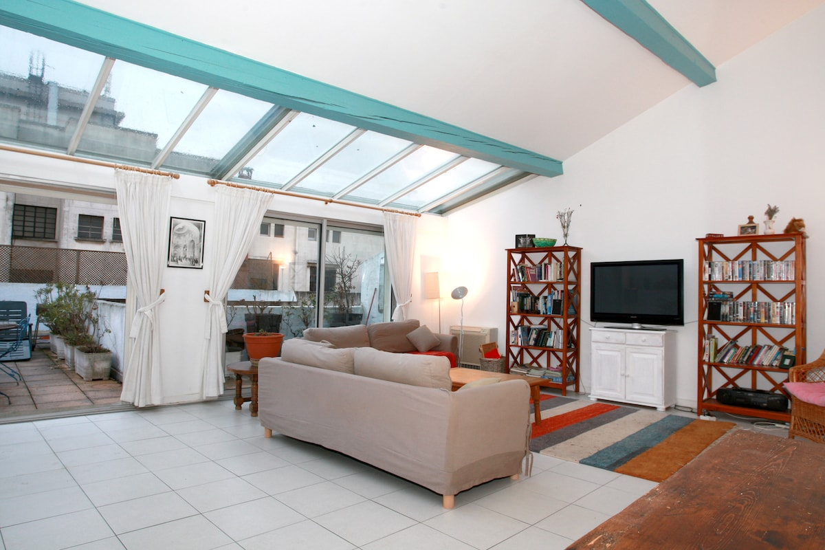 Larger living room with Television sofas and leading to terrace