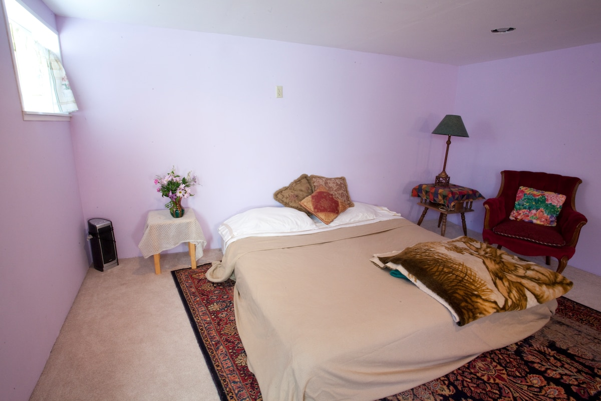 Sleeping area in the basement Great Room, with new windows, Private Shower and W/C