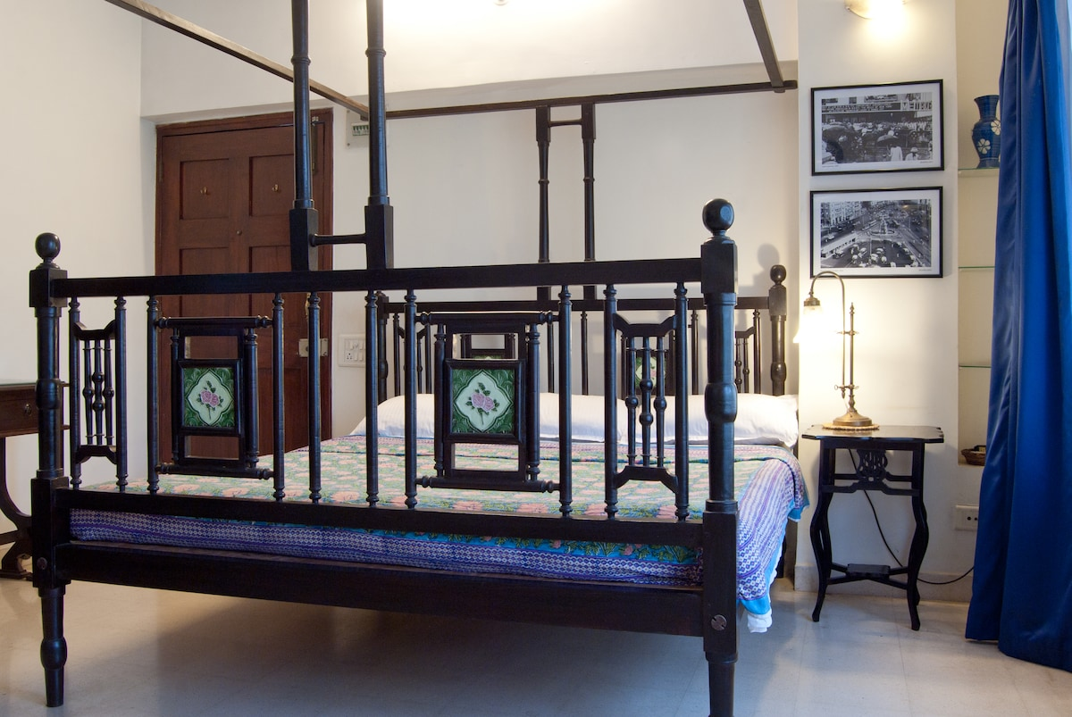 Antique bed and table, tile inlay, vintage fittings, and b/w memories of the beauty of olde worlde Bombay