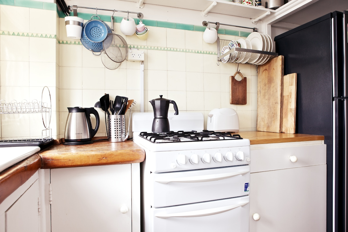Gas stove and oven, with full sized fridge