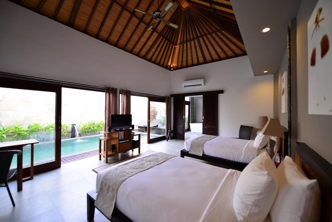 Each villa's bedroom overlooks the pool