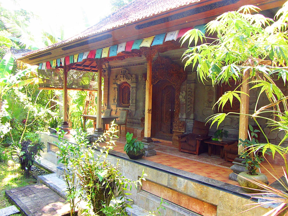 Balinese traditional architecture enhanced by Tibetan prayer flag energy of compassion.