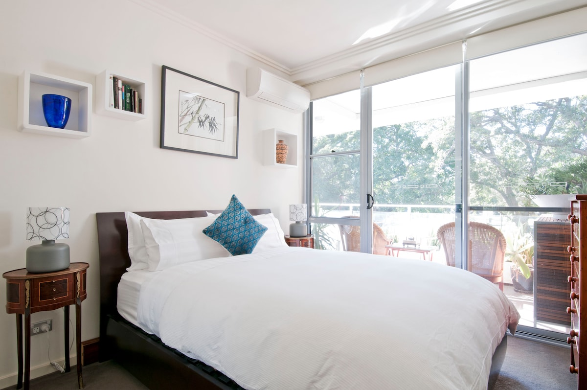 Enjoy a morning lie in on a very comfy bed overlooking the balcony and the park