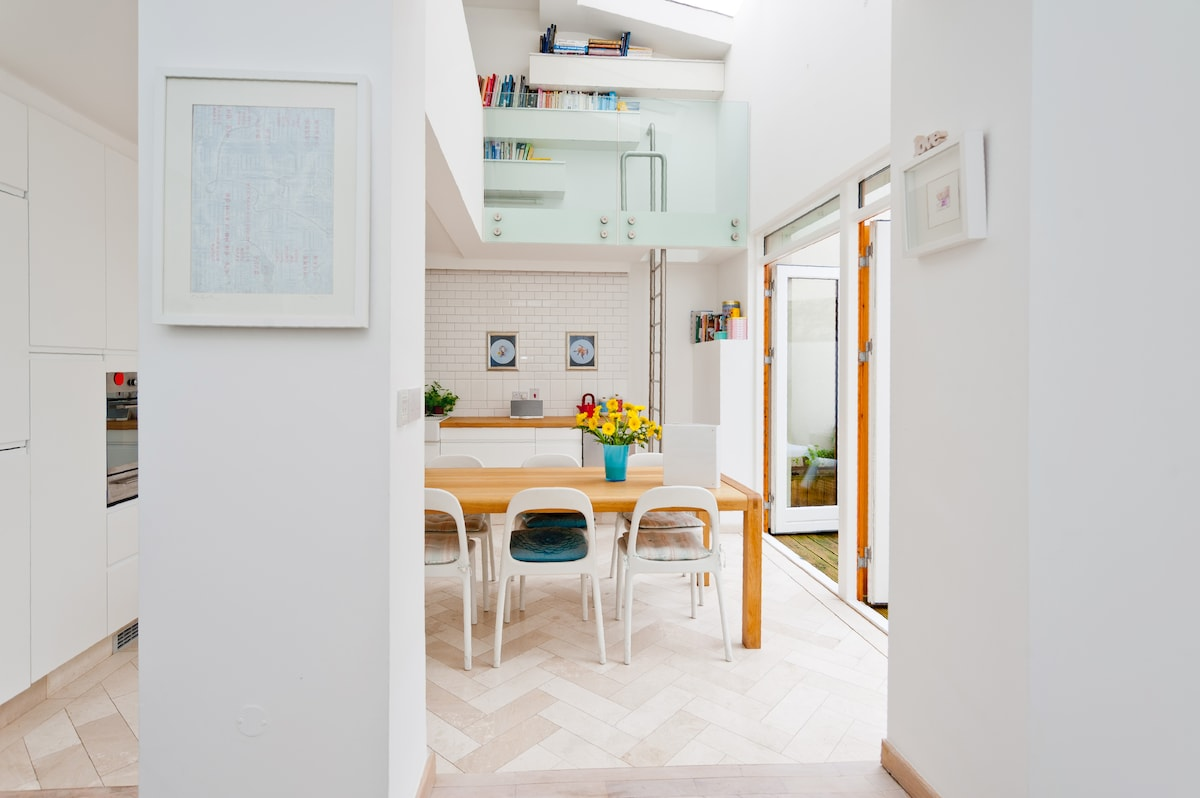 Kitchen, big, bright, and very well equipped. Ladder access to library (also accessible through main bedroom)