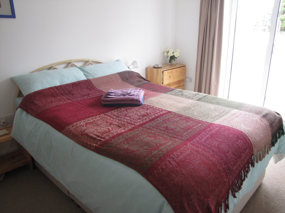 The bed (Double with comfy King Size duvet) in lovely,  clean, light, modern, tranquil, spacious room