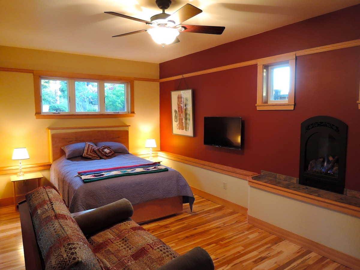 "Queen size bed, full sized sofa/sleeper,  gas fireplace, maple wood floors, 39"" HDTV, clothes closet."
