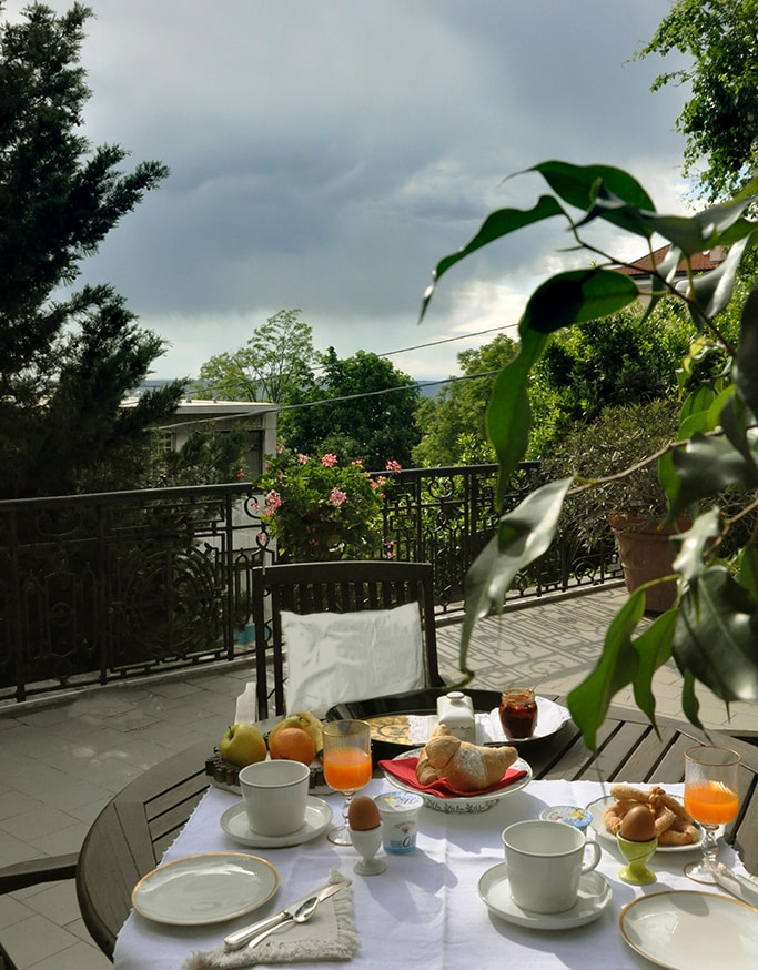 Depending on the season, breakfast is served on the veranda of the romantic garden, or on the rooftop terrace overlooking the Gulf of Trieste.  Or you can get the tray in the room.