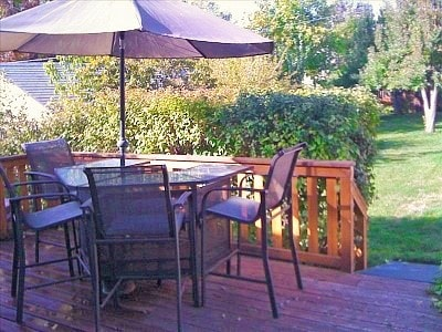 Large, private deck with a grill and a covered table