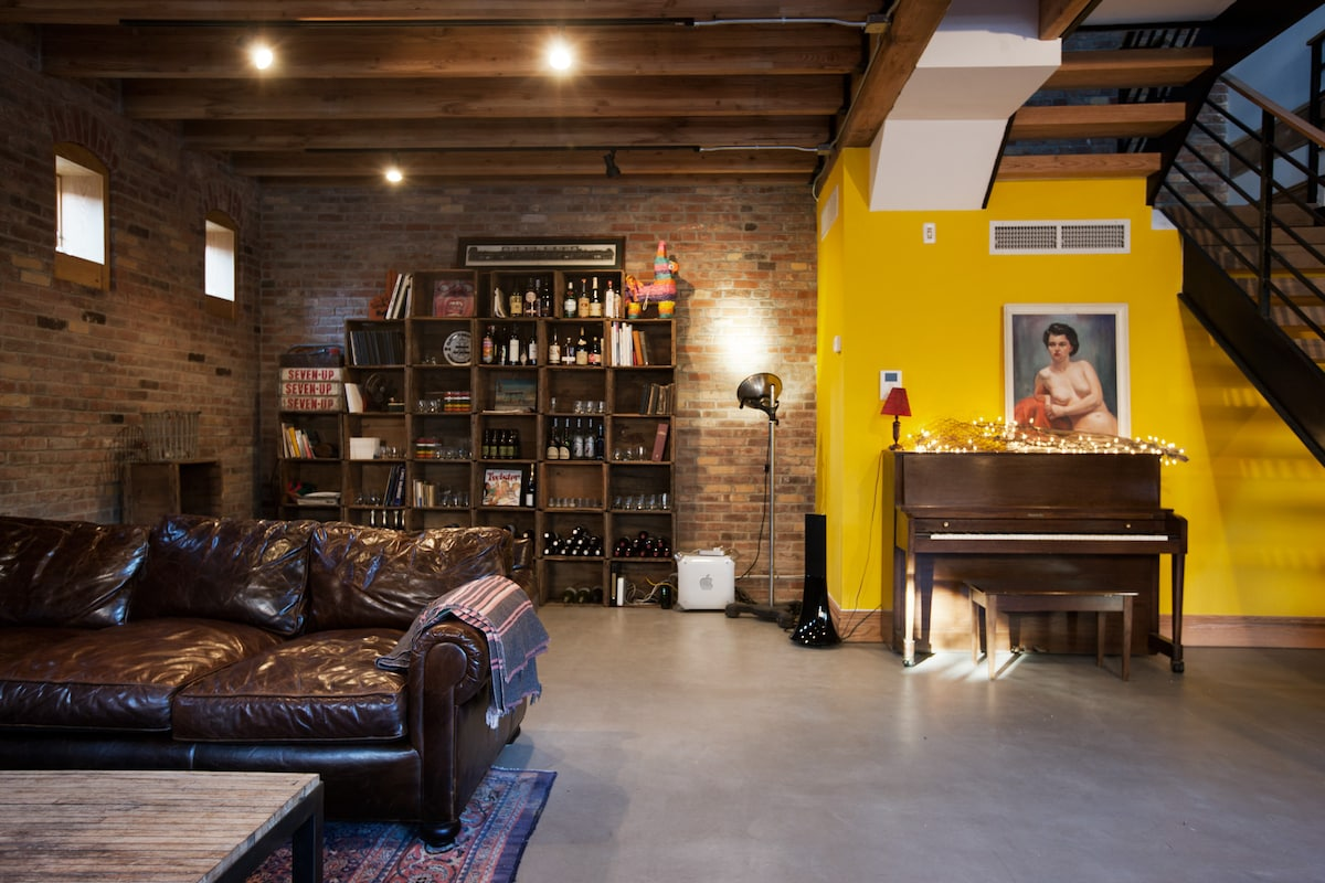 Wall of boxes, main living area, Parrot speakers, piano.