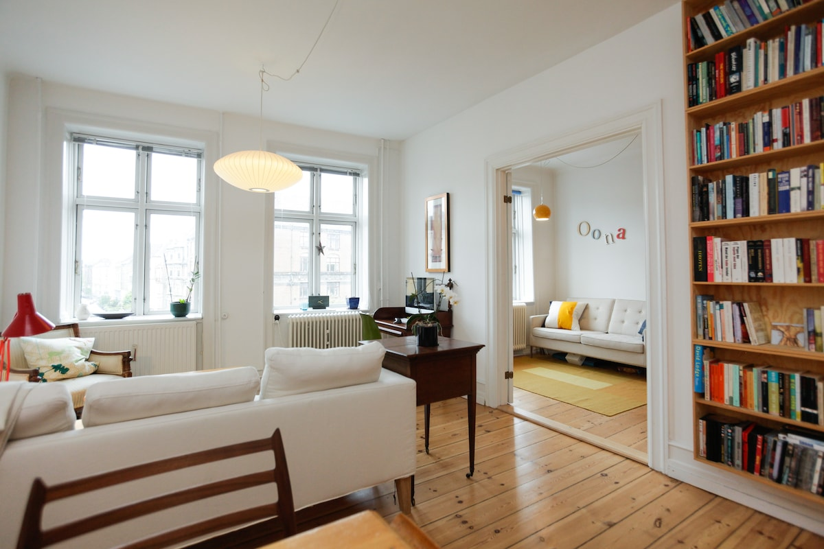 A peek from the spacious living & dining room into the second bedroom/children's room