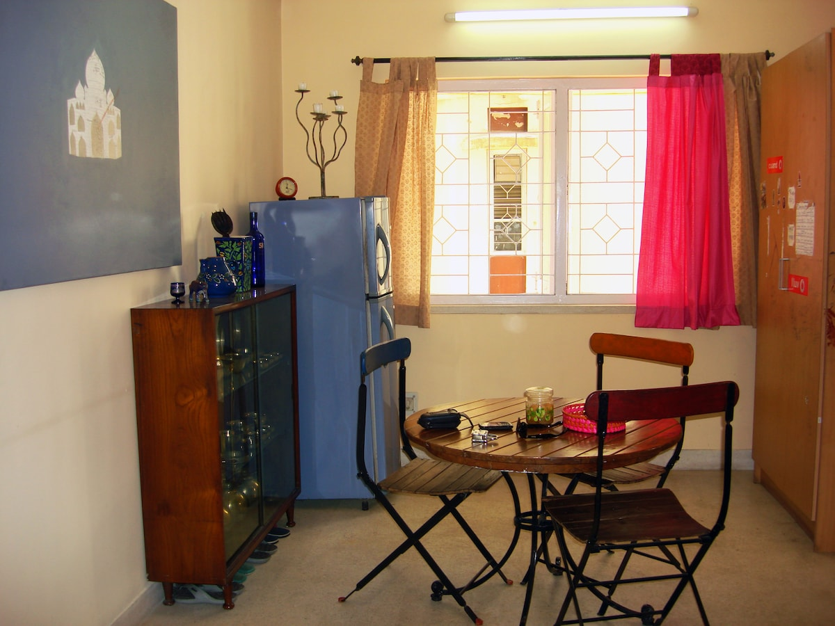 The dining area with refrigerator and a storage cupboard