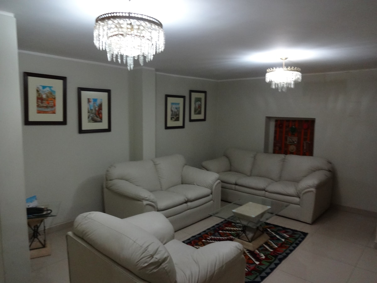 Living room  decorated with 'aquarela' paintings made by local artists.
