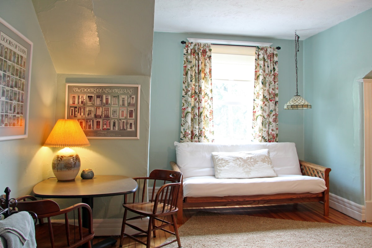 The main bedroom includes a table and chairs and plenty of floor space to spread out.