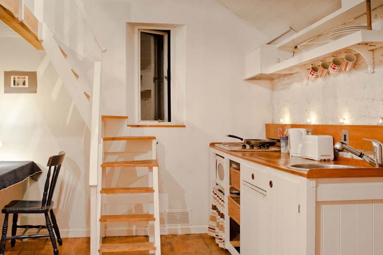 Kitchenette and stairs leading to the mezzanine