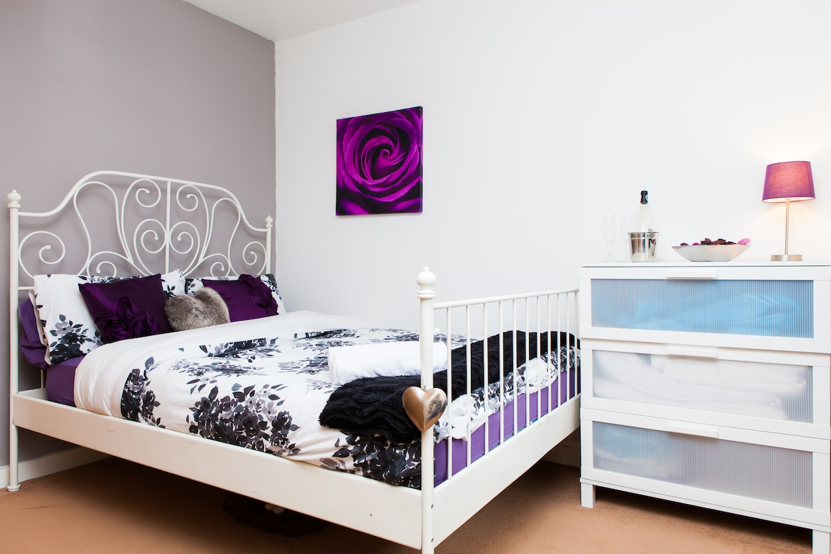 your bedroom with chest of drawers and double fitted wardrobe!