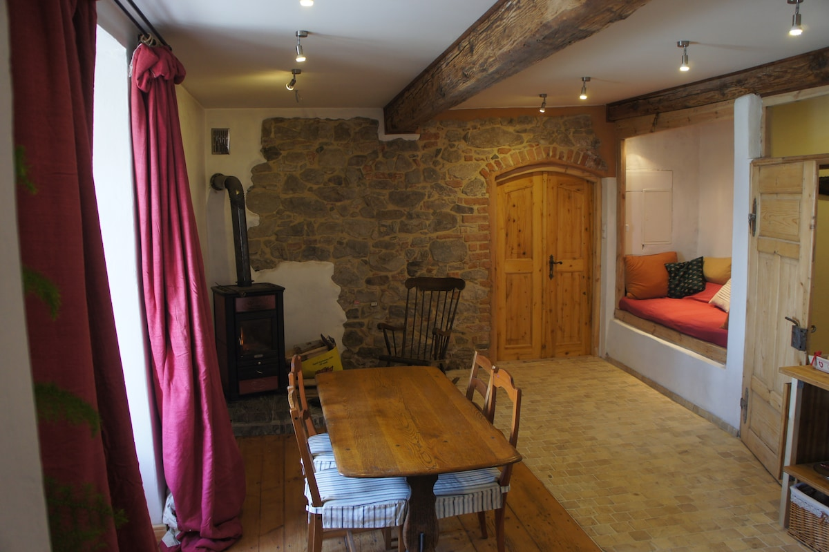 the kitchen dining room in the guest flat. The wood burning stove keeps you roasty-toasty warm