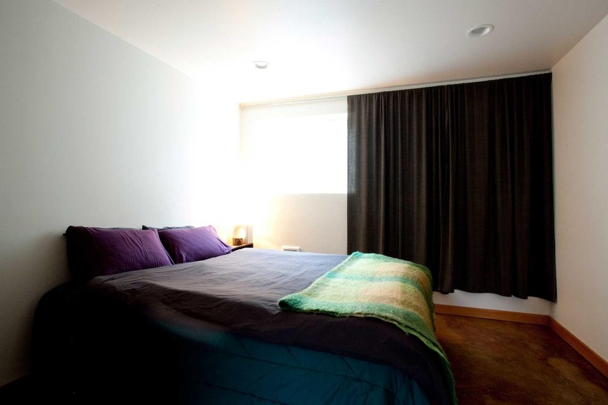 Cozy Queen bed.