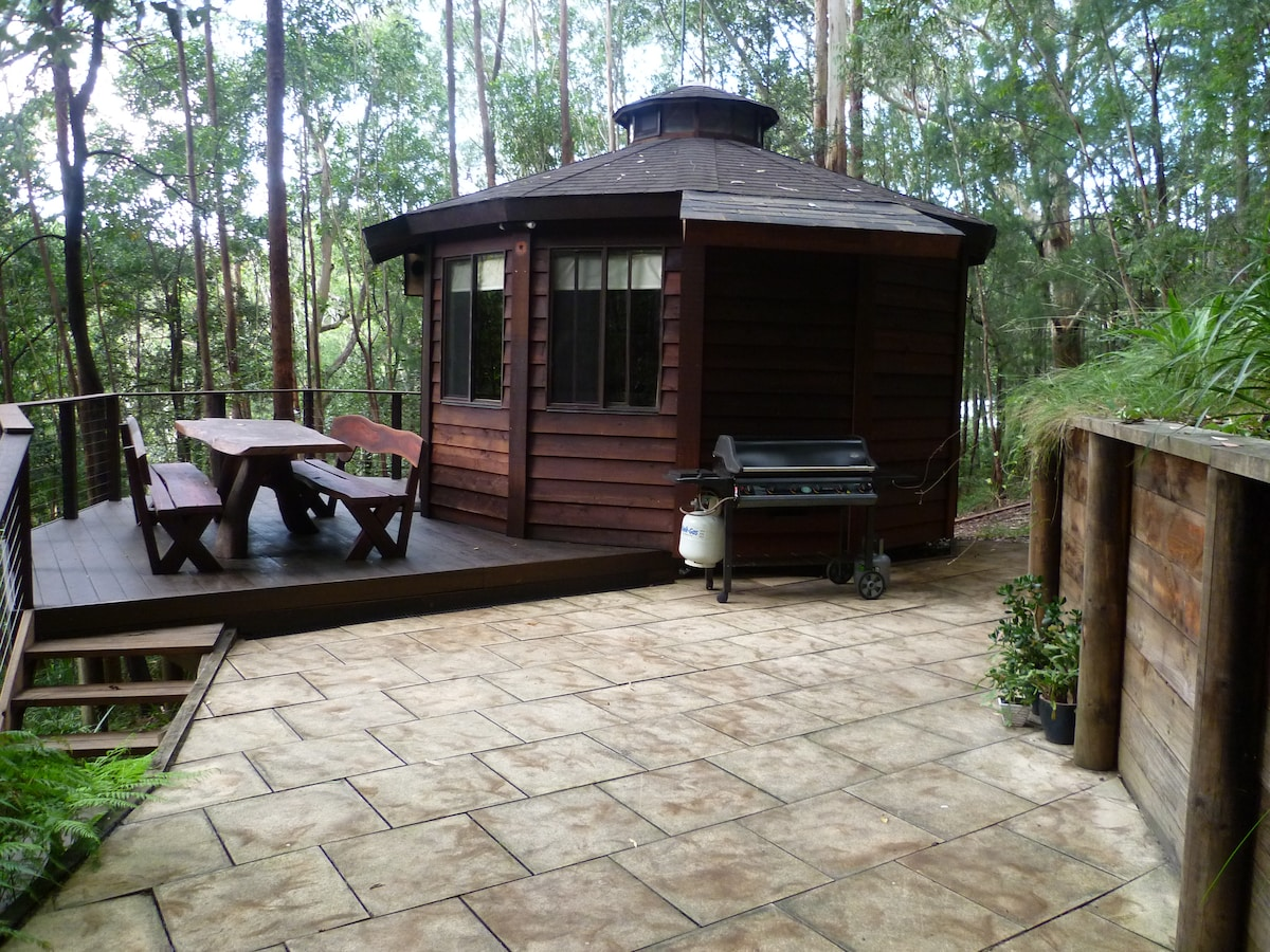 View of yurt from paved area.