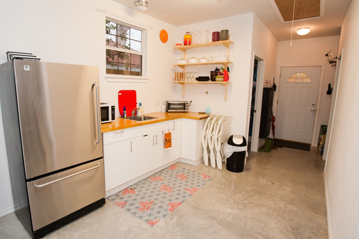 Kitchenette with a full fridge, mini oven and microwave.  Added a full stove top/oven in next photo!
