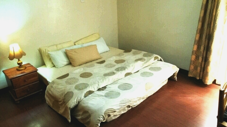 A king-sized bed with a minimum of at least five pillows and a snug-as-a-bug duvet awaits you.