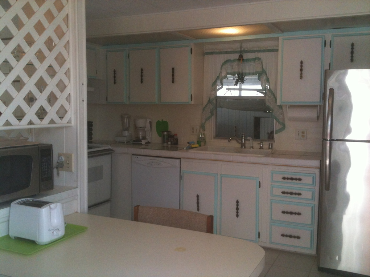 full kitchen, big double sink, glass cooktop; (no dishwasher)