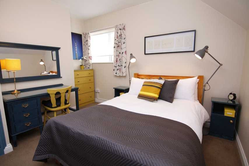 The master bedroom features a double bed with lockers, reading lights, full length mirror....
