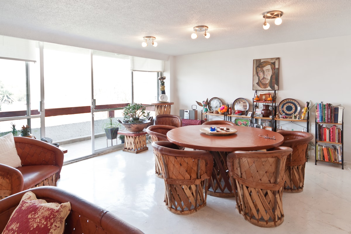 Large open living room dining room area with access to balcony.