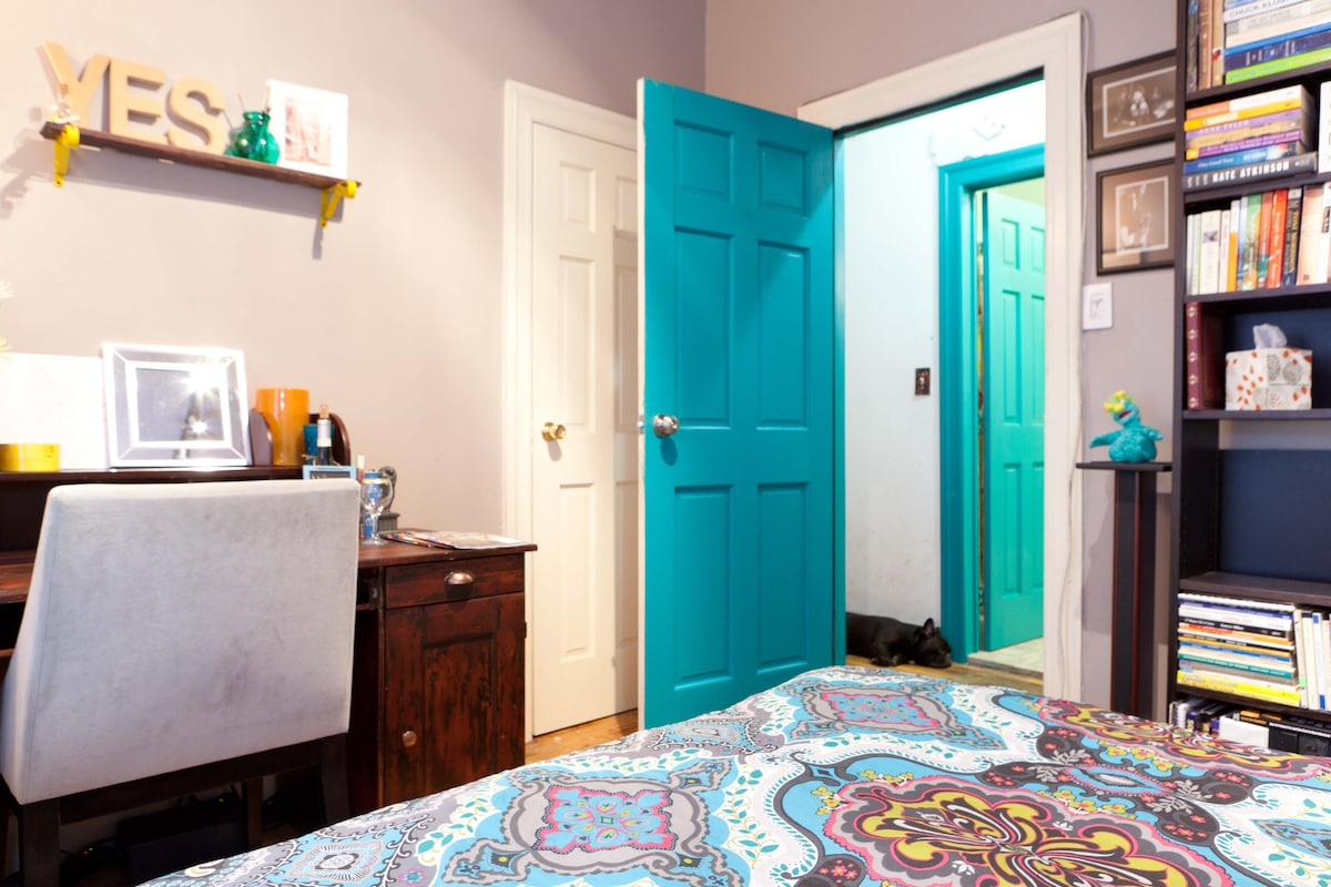 A closet for your stuff behind the white door!