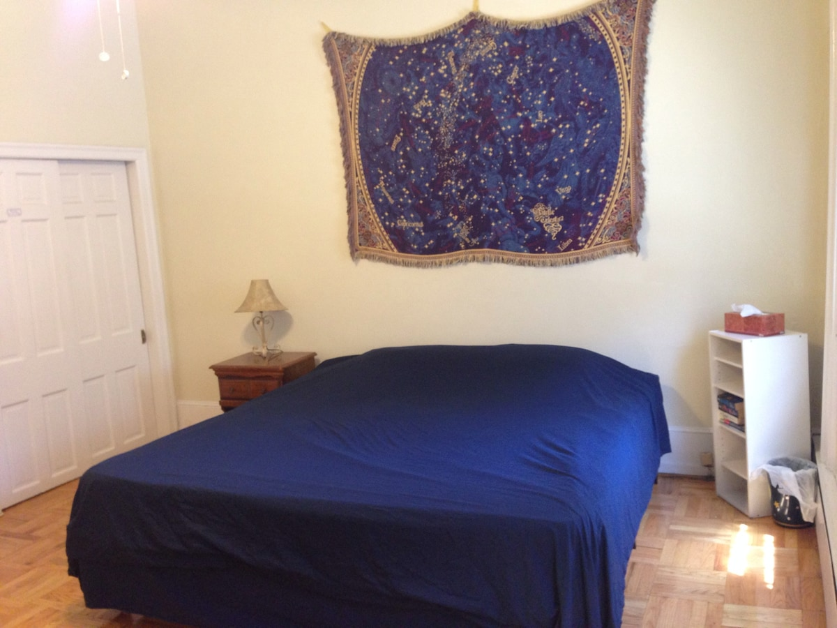 The room gets wonderful natural light, and has a closet for guest use. (Photo: July 2014)