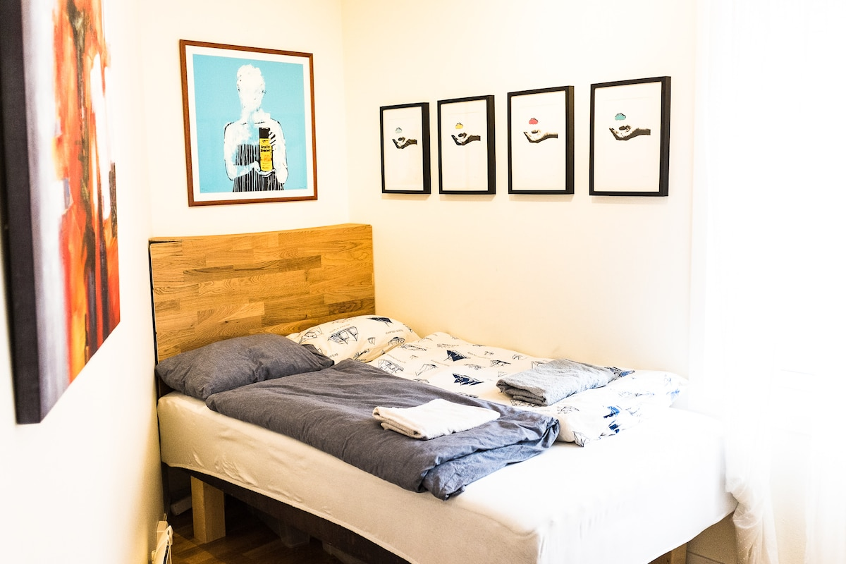 Your bedroom with 120cm bed with clean sheets and provided towels awaiting.  Contemporary/urban art-aficionados may recognize the print over the headboard. It is made by the internationally acclaimed street artist DOLK, who is originally from Bergen.