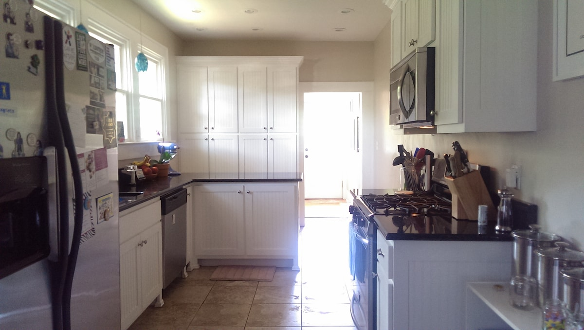Here's a shot of the kitchen, leading out to the back deck and fenced in yard :-)
