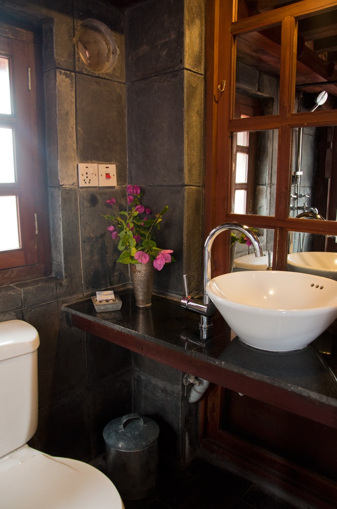Slate and wood bathroom with 24 hrs hot water.