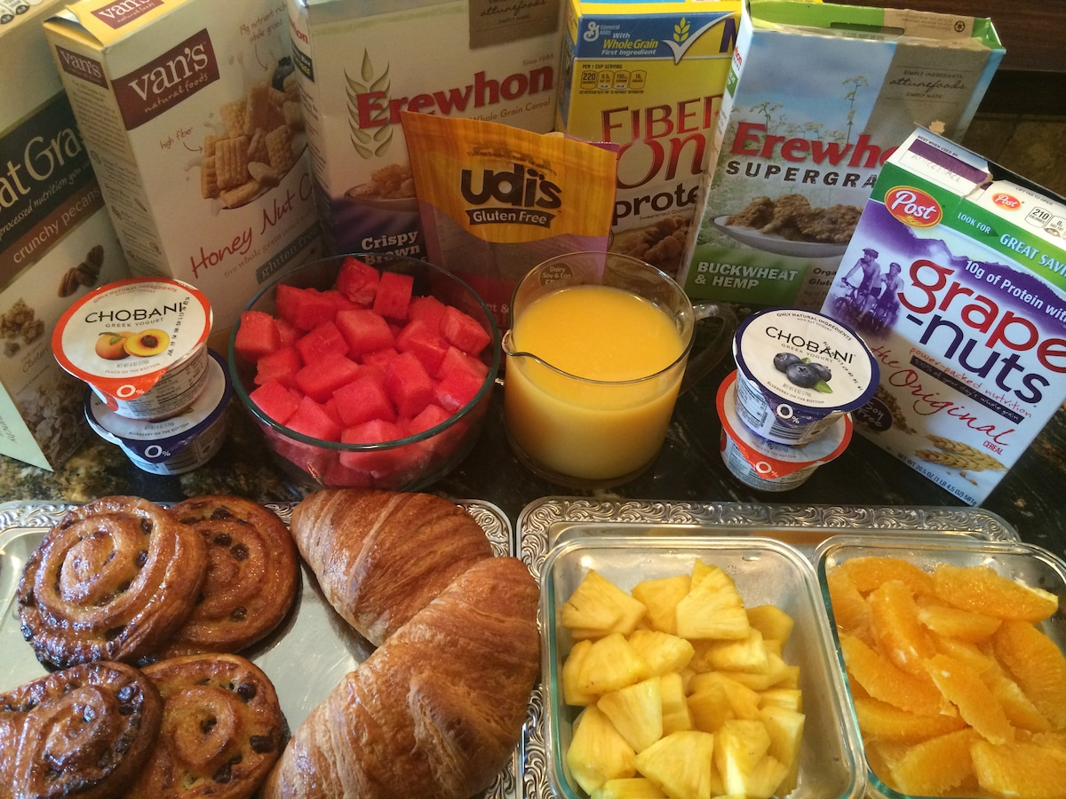 Cardinals Inn Continental Breakfast (inc. gluten-free & vegan) with Fresh Baked Butter Croissants, Fresh Fruit, Yogurt, Cereals with Latte, Cappuccino, Espresso, Americano or Tea and OJ